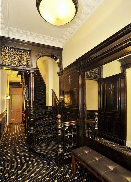 West 88th Street New York Victorian interior foyer stairs crown molding dark woodwork by techpro12, via Flickr