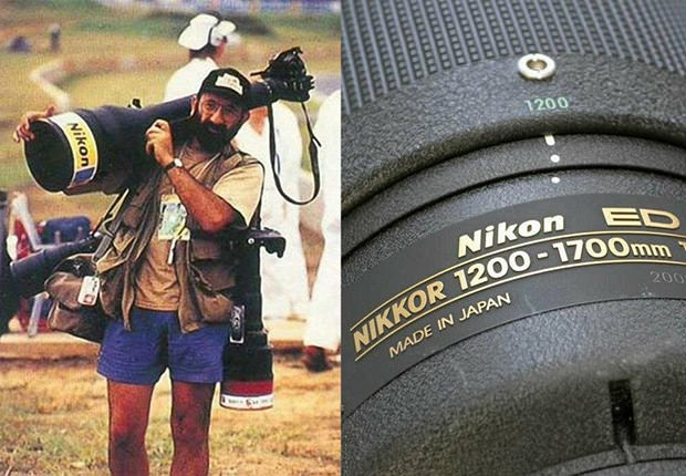 This is, in fact, the proper way to carry the Nikkor 1200-1700mm f/5.6-8.0 super telephoto lens. Weighing in at 36 pounds and measuring nearly 3 feet in length, the manual focus lens was introduced in 1993 and had a hefty price tag of $60,000. It would be interesting to see how it stacks up against the magical Sigma 200-500mm.