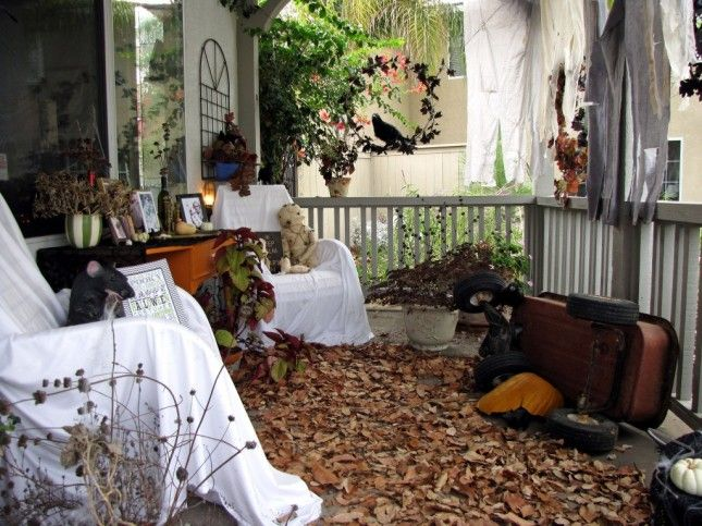 """Dead leaves, busted pumpkins and covered furniture make for that abandoned haunted house feel. Add some candles when the sun goes down, and just like that, your house is transformed to """"the haunted house down the block."""""""