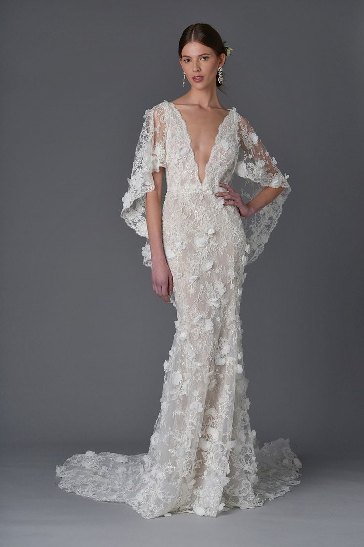 Marchesa wedding dress with plunging neckline and cape sleeves - click through to see the full collection