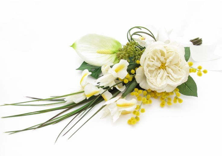 A unique sheaf bouquet of irises, bear grass, a cream peony, phalaenopsis orchids, wattle, seed heads and an anthurium lily.