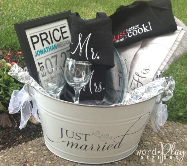 Cute wedding gift basket filled with vinyl crafts:  towels; apron; pillowcases; monogrammed wine glasses, pie plate, picture frame. Sign up for a monthly craft idea-newsletter:  http://www.wordplaydesigns.net/#!wp-newsletter/c1zmd