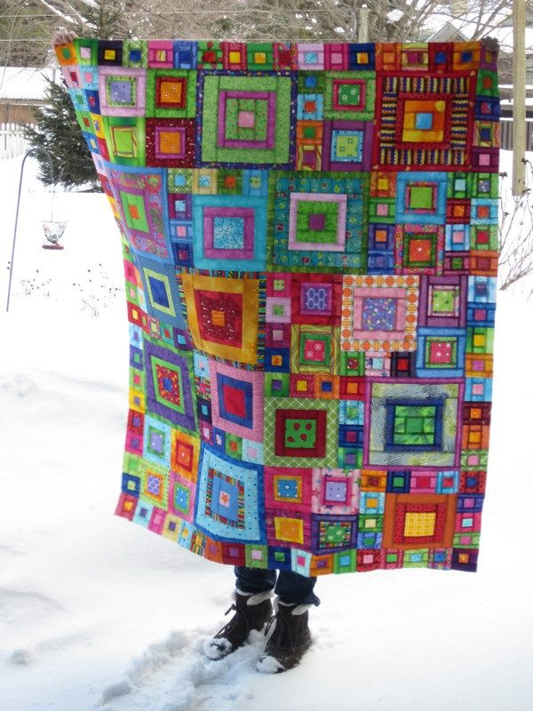 I remember seeing a quilt by Kaffe Fassett where the sunlight shines through the fabric to give it a stained glass effect.