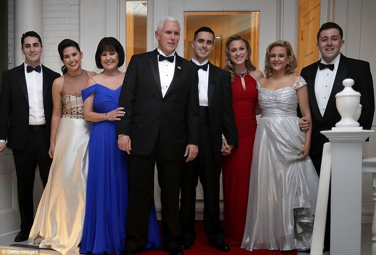 Vice President Mike Pence proudly showed off the Second Family on Friday as they emerged from the Naval Observatory. His daughters Audrey (left) and Charlotte (right) wore pale shades to the white of the flag, his daughter-in-law Sarah wore red and his wife, Karen, stunned in electric blue