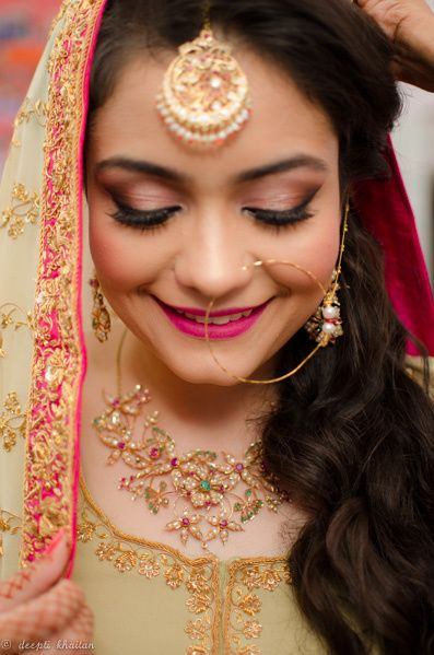 Bride Wearing Maangtikka Nath and Stone Work Necklace