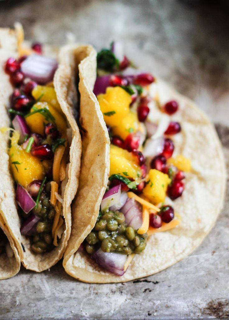 Vegetarian lentil tacos in an amazing homemade salsa verde green sauce then topped with a mango-pomegranate pico