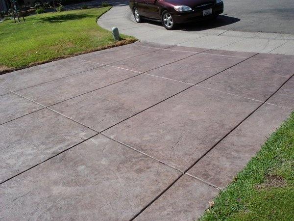 Stamped Concrete Expansion Joints : Stone textured stamped concrete driveway with a geometric