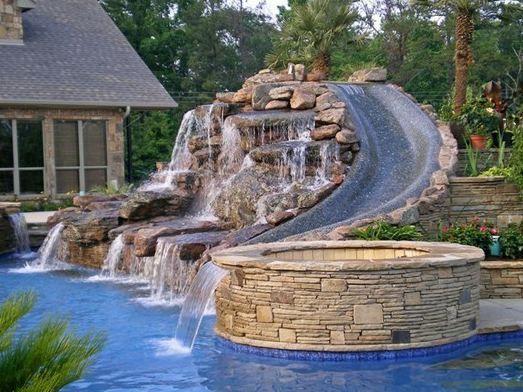beautiful pool slide and jacuzzi
