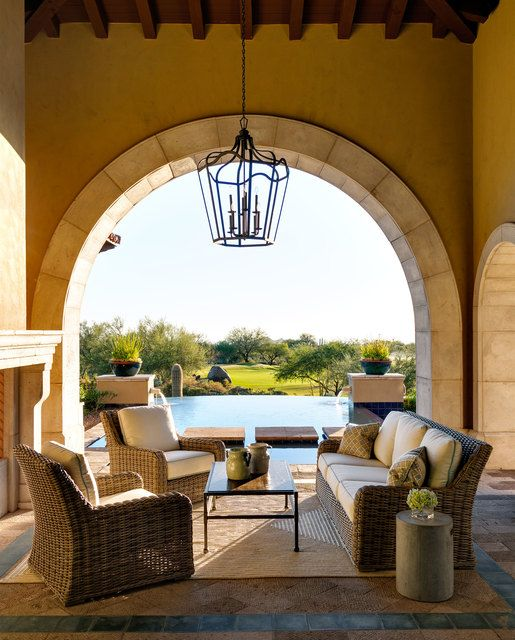 The wicker furniture in the outdoor living room is comfortable and perfect for enjoying the views of the golf course and infinity pool.