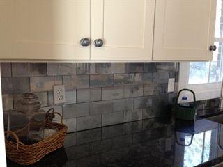 Faux Mercury Glass Tile Backsplash using Krylon Looking Glass Spray Paint  http://www