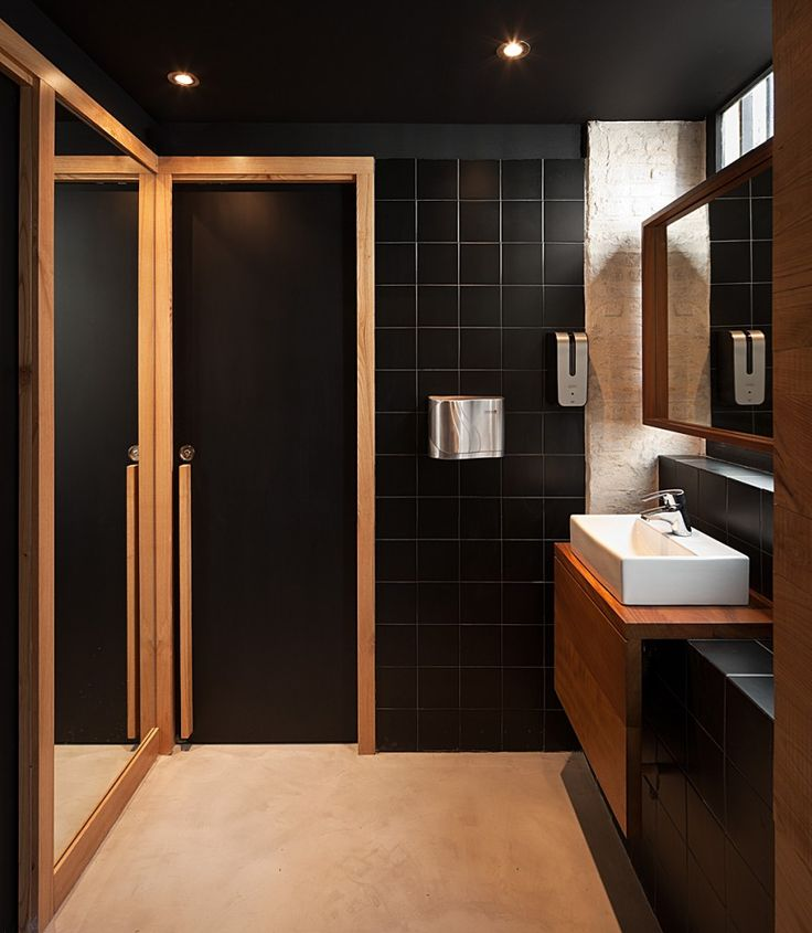 bathroom - black tiles + wood