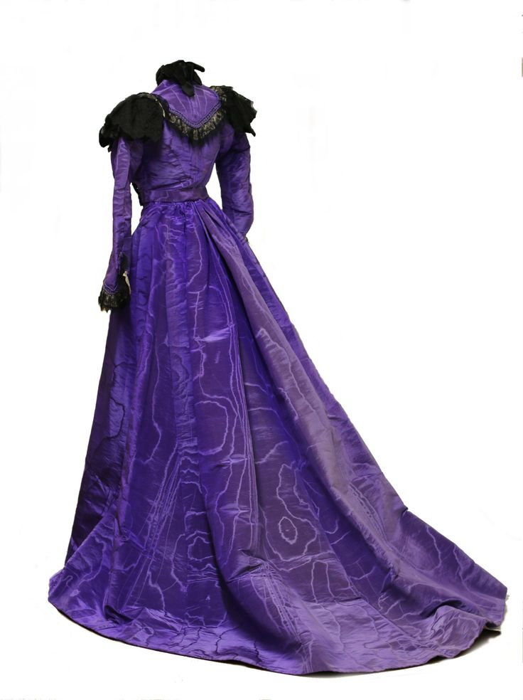 theclothingproject: Collection's Highlight: Purple Moiré Silk Dress Jane Gaston Wood (?-1907) a Quaker of Aurora, New York married Reverend Edward Taylor (?-1902) of Lee, Massachusetts on October 6, 1847. Jane Gaston Wood wore this purple silk moiré dress in a photograph commemorating her 50th wedding anniversary in 1897. The train on this piece is quite simply breathtaking. The lighter spot seen on the back of skirt is light damage from the garment's time before it became part of the ...