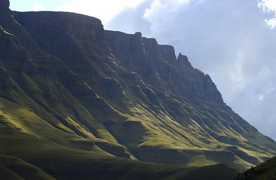 The towering mountains that lead to Sani Pass http://www.n3gateway.com/the-n3-gateway-route/southern-drakensberg-community-tourism-organisation-sdcto.htm