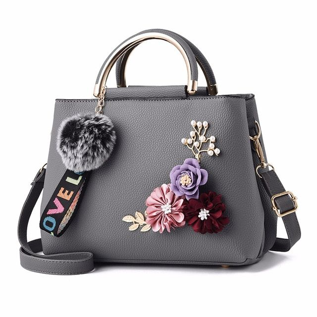 Ladies bag leather-based purse girls shoulder bag tote flowers shell sac a foremost femme rivets fur ball pendant girls