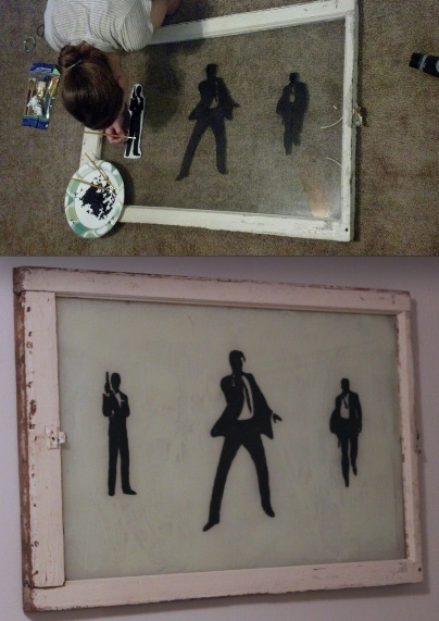 DIY James Bond distressed wall art for bachelor pad.  1. Buy an old window at a thrift store  2. Print silhouettes & tape them to the back side  3. Paint with black acrylic paint from Walmart.  4. Frost the back with white spay paint.  5. Hang and enjoy!