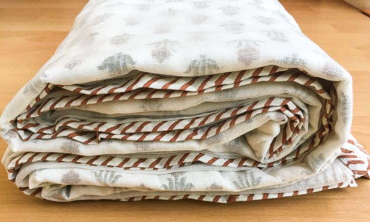 This custom handmade bed sheet consists of 3 layers: • First layer is fine 100% cotton muslin. • Second layer is an organic Cotton fabric that is printed on using intricately carved teak wood blocks and richly colored natural dyes; a process popularly known as hand block printing. • Third layer is fine 100% cotton muslin. The very smooth translucent outer layers allow the printed design to peek through so that there is no right and wrong side. The resulting pieces are stunning and one of a…