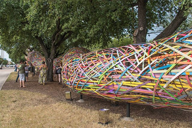 The Funnel Tunnel Snakes its Way Through the Streets of Houston wood installation - Patrick Renner