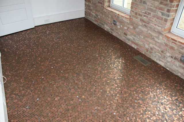 Floor made from pennies - concrete board, grout and three coats of laquer