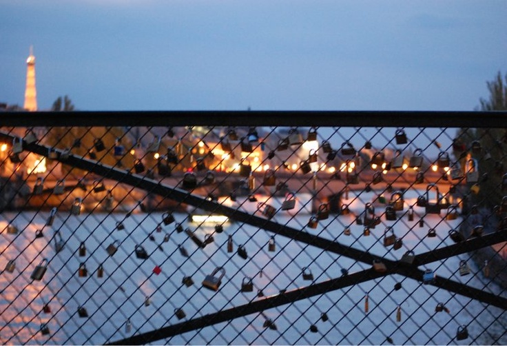 Pont des Arts Bridge in Paris.  Buy a lock to secure your love for someone. Then you throw the key into the river.