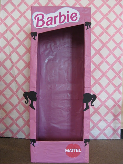 Photo session for each lady inside the lifesize barbie box! made out of cardboard and wrapped with pink paper. Fun hen party idea :)