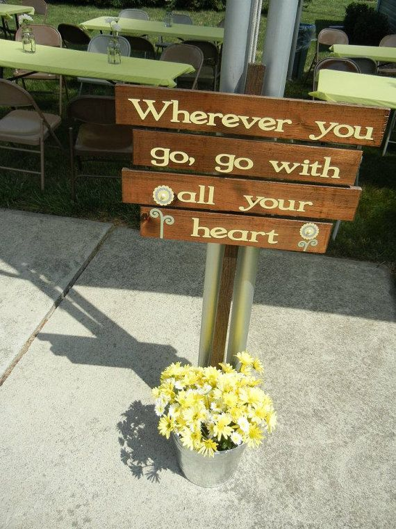 Wedding signs planted in a gray/galvanized steel pot with yellow and white flowers