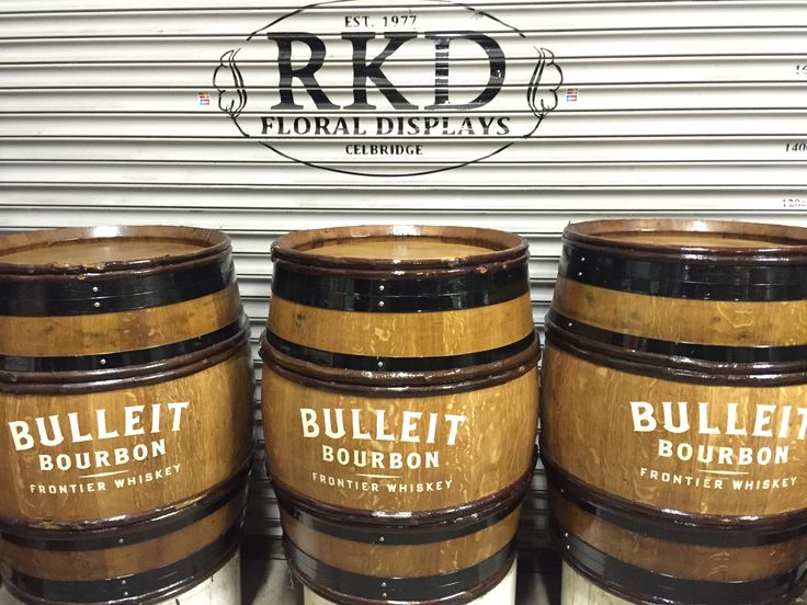 Branded hazel band wine barrels By RKD Floral Displays