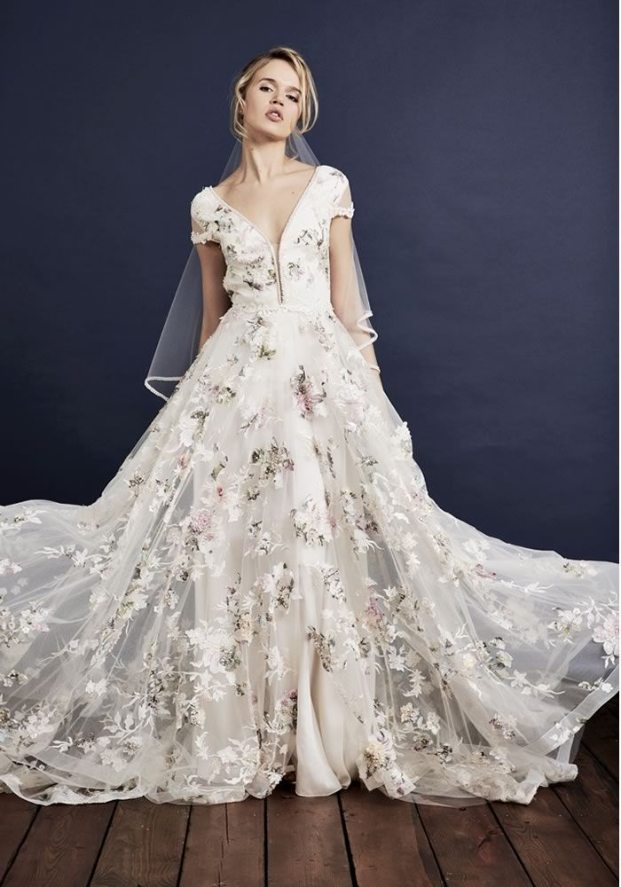 Brides will ADORE this floral embroidered wedding dress, featuring vintage-style design and pretty capped sleeves with an ever so slightly boho flair. Savin London launch show-stopping new Floral Love 2018 collection of bridal gowns • Wedding Ideas magazine