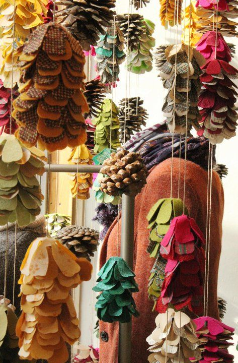 Autumn window concept at Anthropologie store in Roseville, CA. Pine cones, multicolored handmade fabric pinecones, and twine. Visual Internship, Megan Udell, Fall 2011