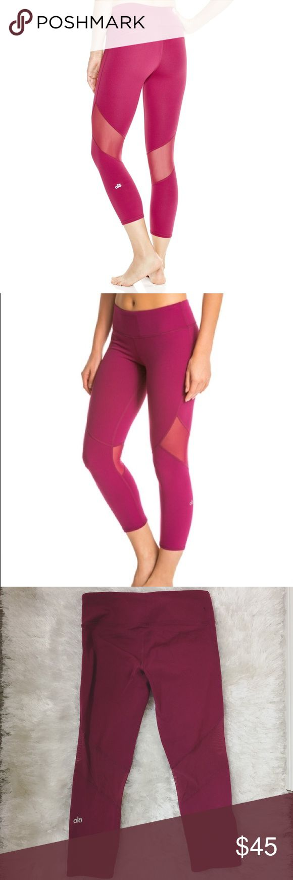 LIKE NEW Alo Yoga Mesh Fuchsia Pink Capri Legging Barely used Workout gym leggings Capri. Alo Yoga Go Capri with Mesh accents on the back and sides. Perfect for ventilating your legs. Like most Alo Yoga pants, it features a small pocket on the front top hem of the pants for keys/cash. Super stretchy and GREAT material. It's not thin or cheap. There's a small faded spot on the pant (like 1cm) . It's on the last photo bottom left. It's hardly noticeable. ALO Yoga Pants Leggings