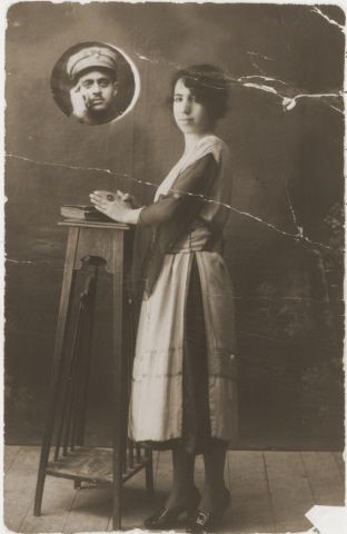 Rachel Mordo with her fiance, in military uniform, appearing in a porthole behind her. 1916. Greece. During the war she was deported to Auschwitz, and from there was sent to other camps, including Bergen-Belsen and Mauthausen. Perla and her unnamed brother survived; her father and brother Moses perished during the Holocaust.