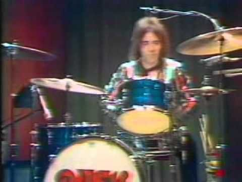 Rush ~ Working Man (early 1974 w/drummer John Rutsey)  Rush is a Canadian rock band formed 1968, in Toronto, Ontario. The band: [bassist, keyboardist, and lead vocalist Geddy Lee, guitarist and backing vocalist Alex Lifeson, and drummer, percussionist and lyricist Neil Peart]. The band and its membership went through a number of re-configurations between 1968 and 1974, achieving their current form when Peart replaced original drummer John Rutsey in July 1974.