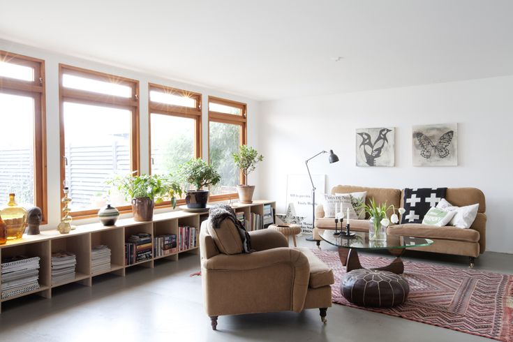Loving the big unit under the windows - storage and a great place for plants. Which are amaze.