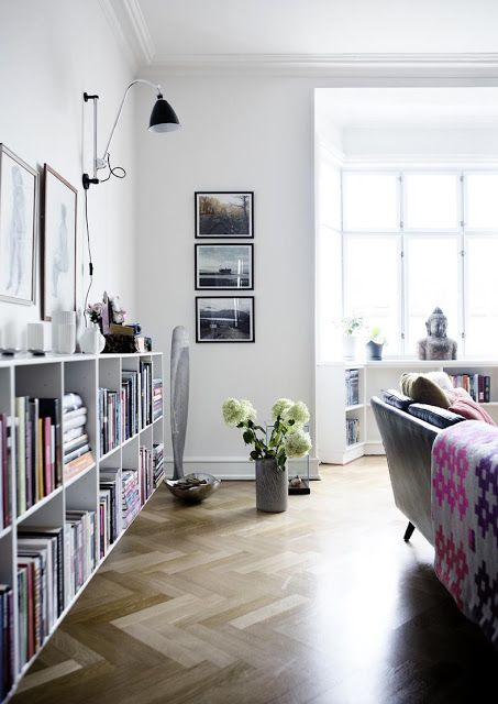 Lovely and airy. Great shelving, parquet floor and bright finishing touches.