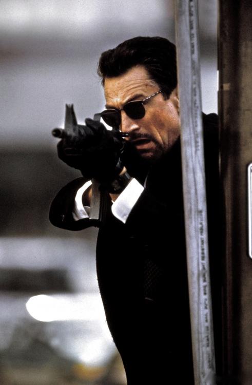 Robert De Niro in Heat with M16 and sunglasses