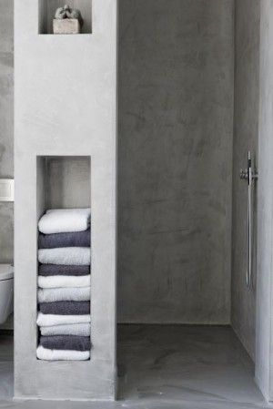 Because wall is deep, towel shelves (glass or wood??) on outside/front and in back, shelves IN shower for shampoo, etc. keeping bottles out of sight.  GENIUS! Use shower tile for continuity