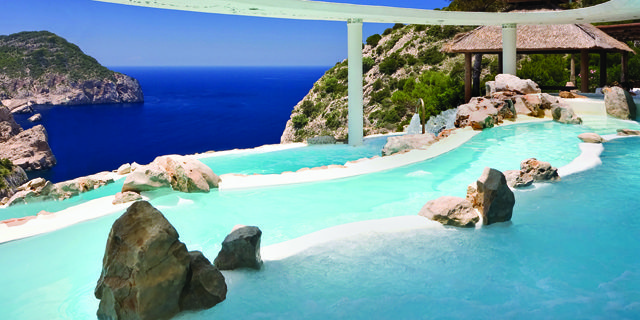 A brilliant swimming pool looking out over the sea, on the coast of the wonderful island of #Ibiza #Spain #seasidehotel