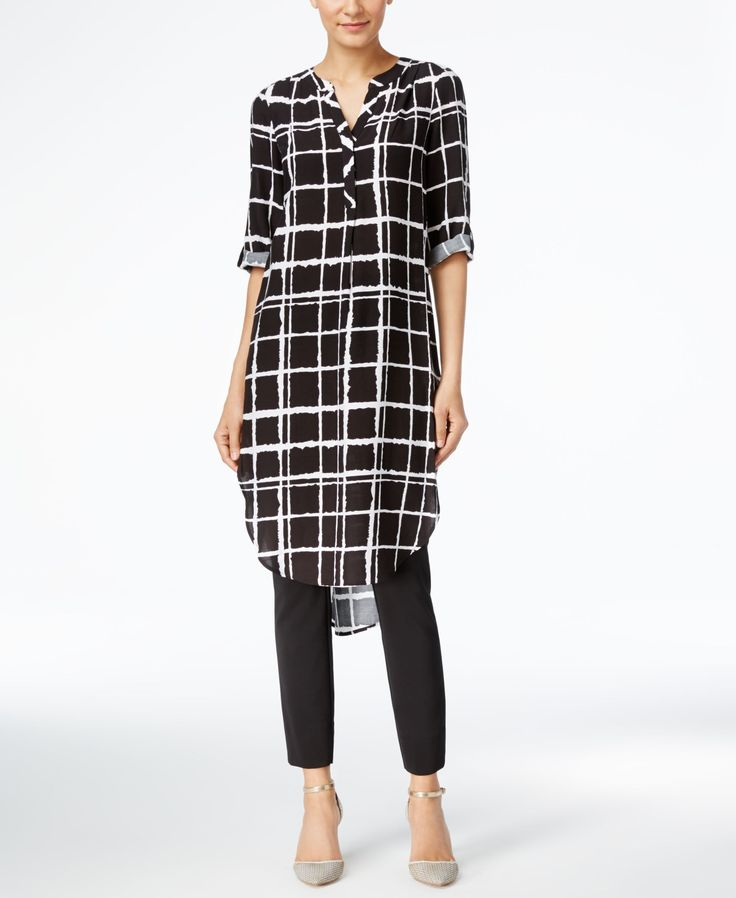 Lend some pizzazz to your ensemble when you wear this plaid-print long tunic…