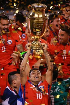 #COPA2016 #COPA100 Gonzalo Jara of Chile celebrates with the trophy after winning the championship match between Argentina and Chile at MetLife Stadium as part of Copa...