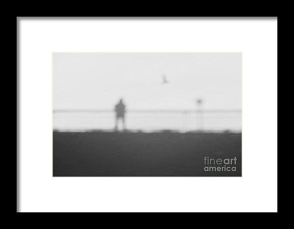 Man On A Bridge With Flying Bird Abstract Shadow On Snow Framed Print