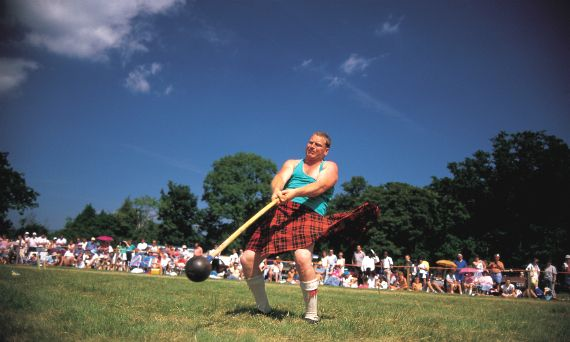 A competitor in action during the hammer event during the Luss Highland Games, near Loch Lomond.