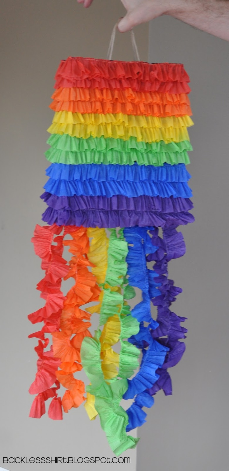 DIY pinata using a paper sack w/ a handle on top to hang the pinata... cover it in crepe paper ruffles... super cheap & easy