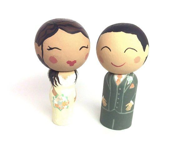 Personalised cake toppers - see more ideas at http://themerrybride.org/2014/09/06/ideas-for-personalising-your-wedding/