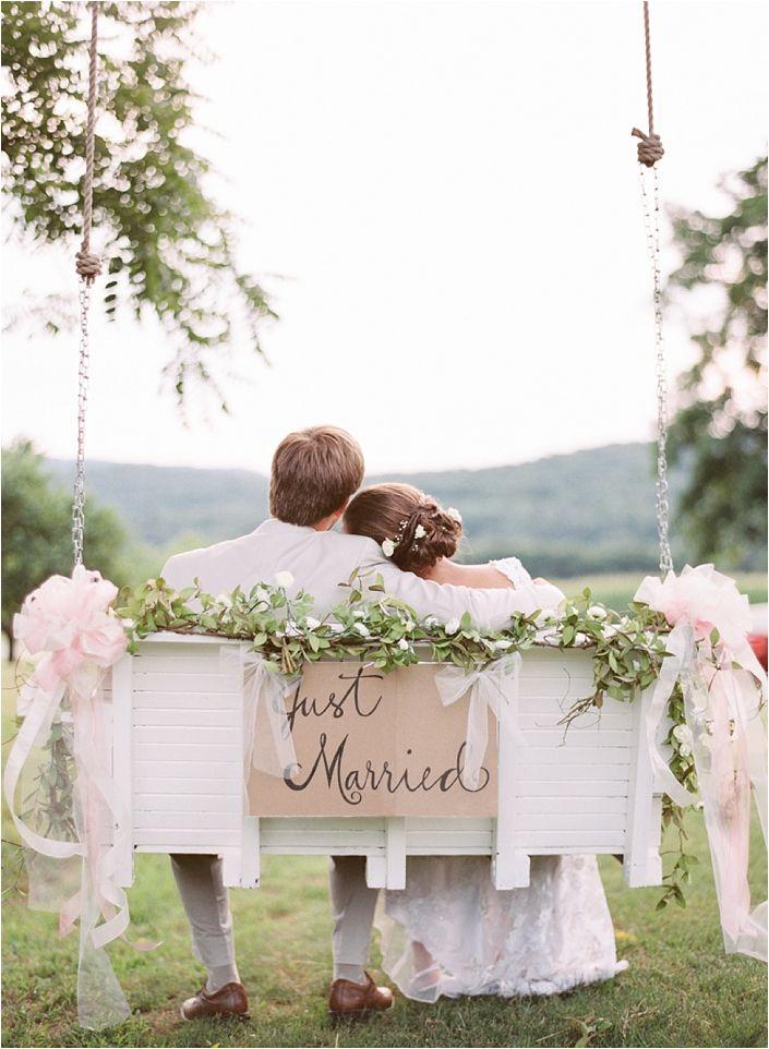 bride and groom in a swing for outdoor garden weddings