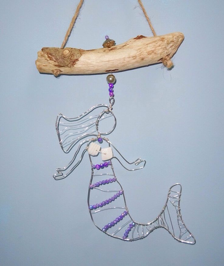 A personal favourite from my Etsy shop https://www.etsy.com/uk/listing/485732302/mermaid-hanging-decoration-beach-decor