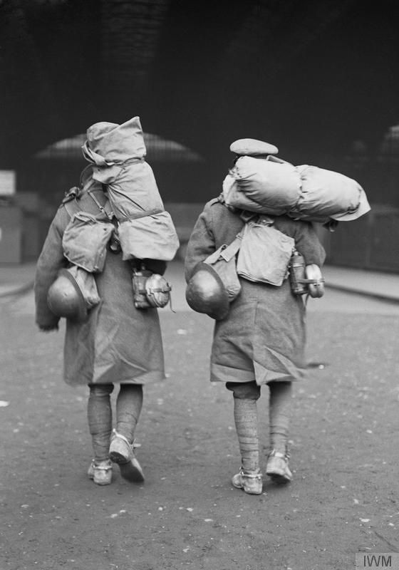 British soldiers loaded with kit, as they arrive at Victoria Station, London, at the start of a period of leave. WWI