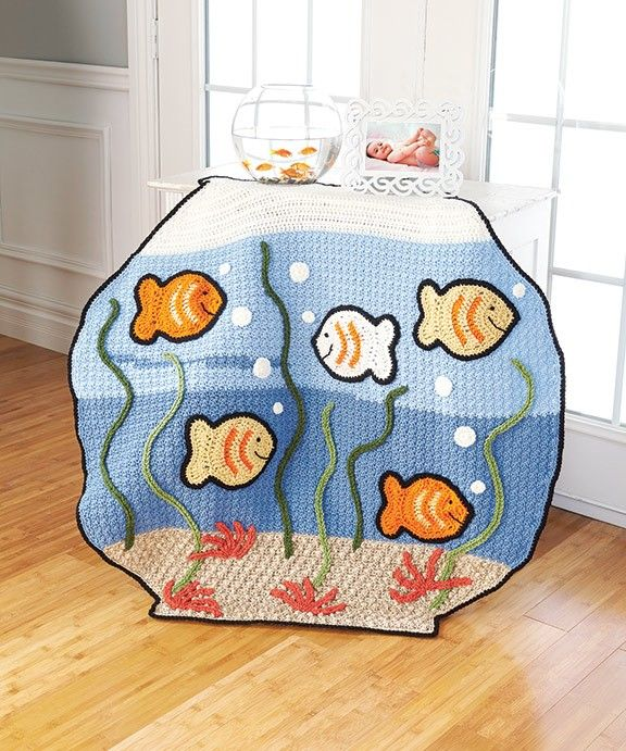 Our 2nd place winner! Designed by Janice Slocum. Adorable fish bowl blanket to crochet. Kit includes Red Heart worsted weight yarns.