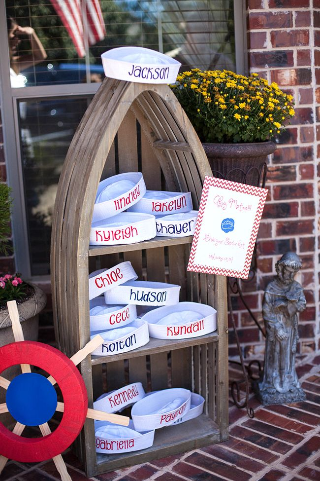 Adorable nautical theme first birthday party- I love the monogramed (well they would be hand - sewn) sailor hats and the lifesaver drinks.