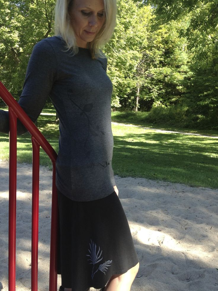 Two Gorgeous Prints designed by Kristina Schlegel for #SqueezedYogaClothing Curvy Vine on the Charcoal Bamboo Long Sleeve Tee and Palm Print on the Black Bamboo Skirt.        http://squeezed.ca/shop/category/bamboo