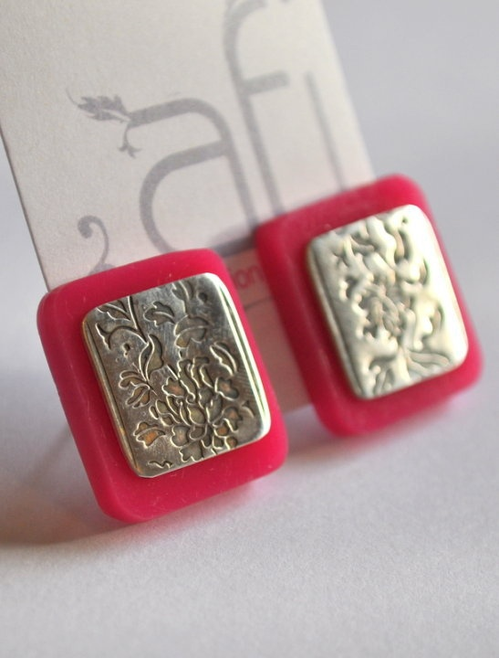 embossed silver and pink perspex studs