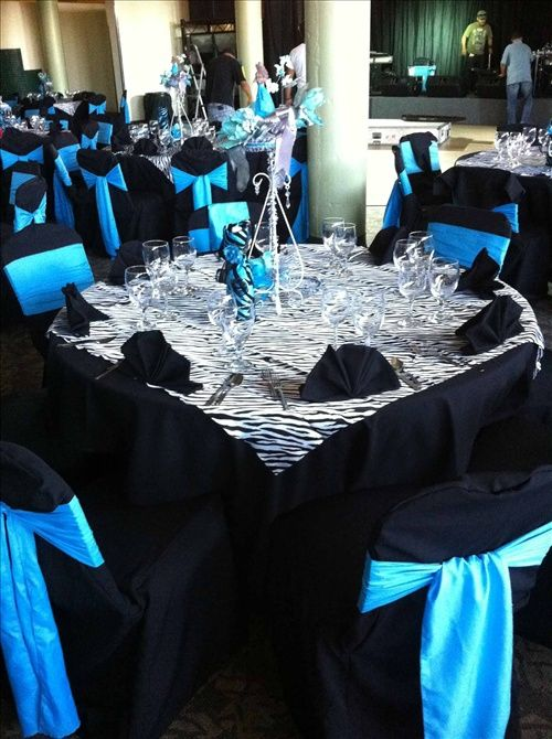 really think black table clothes and chair covers would be much prettier